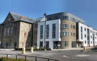 LLA designed housing scheme in Camborne. Brick flat complex