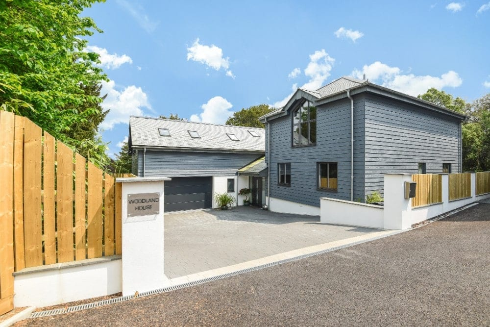 Contemporary family home with long driveway and grey slats