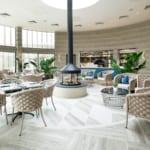 The Headland Hotel Aqua Centre seating area and log burner